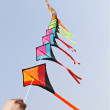 Colorful kites on blue sky — Stock Photo #12822639