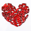 Stock Photo: Heart made of red capsule