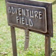 Advanture field wooden sign board — Stock Photo #22854682
