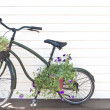 Royalty-Free Stock Photo: Old black bicycle with flowers