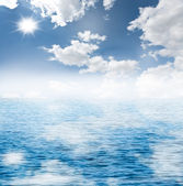 Cloudy blue sky and the blue sea — Stock Photo