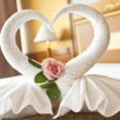 Honeymoon Bed Suite decorated with flowers and towels — Stock Photo #27306145