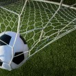 Soccer ball in goal, success concept — Photo