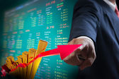 Business man point to up graph of stock market — Stock Photo