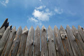 Rural paling from logs against the sky — Stock Photo