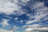 Blue sky with clouds closeup — Stock Photo