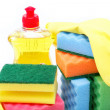 Detergent bottle, rubber gloves and cleaning sponge on a white b — Stock Photo #12857590
