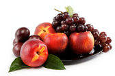 Fruits nectarine and a bunch of grapes isolated against white ba — Stock Photo