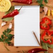 Stock Photo: Notebook for recipes, vegetables and spices on wooden table.