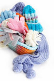 Winter accessory collection. Hat, scarf and mittens in the conta — Stock Photo