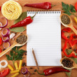 Notebook for recipes, vegetables and spices on wooden table. — Stock Photo #13962121