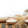Stock Photo: Flour and wheat grain with wooden spoon on wooden table.