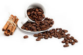 Cup with coffee beans isolated on white background. — Stock Photo