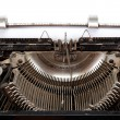 Old typewriter with sheet of paper — Stock Photo #14687515