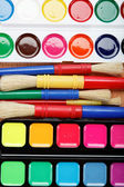 Paint and brushes on a wooden table. — Stock Photo