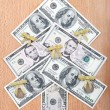 Christmas tree made ​​out of American dollar bills on a wood — Stock Photo