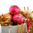 Christmas decorations in a gift bag, isolated on white backgroun — Stock Photo