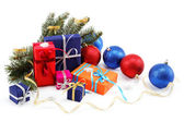 Christmas decorations and gifts on a white background. — Stock Photo