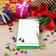 Christmas decorations, gifts and a notebook for congratulations. — Стоковая фотография