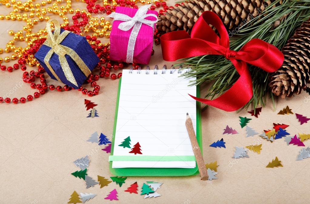 Christmas decorations, gifts and a notebook for congratulations.   Stock Photo #16889277