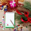 Christmas decorations, gifts and a notebook for congratulations. — Stock Photo
