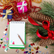 Christmas decorations, gifts and a notebook for congratulations. — Foto de Stock