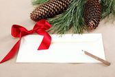 Christmas decorations, a blank and a pencil for congratulations. — Stock Photo