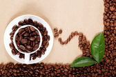 Cup with coffee beans. — Stock Photo