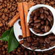 Cup with coffee beans and cinnamon sticks. — Stockfoto