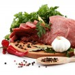 Raw meat, vegetables and spices on a wooden cutting board isolat — Stock Photo