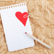 Stock Photo: Sheet of notebook with heart and pencil on crumpled paper. Val