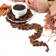 Cup with coffee beans and cinnamon isolated on white background. — Stock Photo