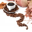 Stock Photo: Cup with coffee beans and cinnamon isolated on white background.