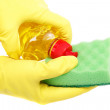 Hands in rubber gloves with a bottle of detergent and sponge on — Stock Photo #19862669