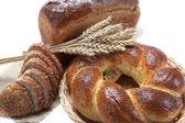 Fresh breads isolated on white background. — Stock Photo