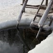 Staircase and a ice hole for the winter swimming at the river. — Stock Photo #20976015