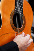 Guitarist hand playing acoustic guitar. — Stock Photo