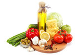 Set fresh vegetables with olive oil isolated on white background — Stock Photo