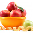 Fresh apples in a bowl and measuring tape isolated on white back — Stock Photo