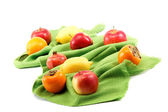 Set of different fresh fruits on green cloth. — Stock Photo