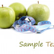 Fresh apples with measuring tape. isolated over white background — Stock Photo