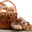 Large variety of bread in a basket on sackcloth. Still life isol — Stock Photo #24712949