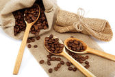 Coffee beans and spoons on sacking. — Стоковое фото