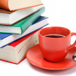 A stack of books and a cup of coffee on a white background. — Stock Photo