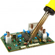 Board and a soldering iron isolated on a white background. — Стоковая фотография