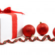 White gift box with red ribbon and christmas balls. — Stock Photo