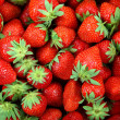 Fresh strawberry fruit as backdrop. — Stock Photo #26960865