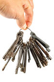 Bunch of old keys in hand isolated on a white background. — Stock Photo