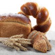 Fresh breads for a variety isolated on white. — Stock Photo