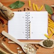 Notebook for recipes and spices on wooden table — Stock Photo #27071783